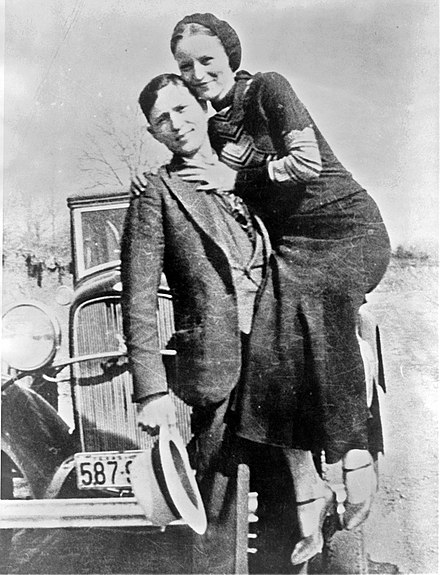 Bonnie and Clyde in March 1933 in a photo found by police at an abandoned hideout Bonnieclyde f.jpg