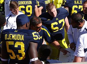 Brady Hoke - Hoke and Jerry Montgomery with defensive linemen in 2012.