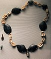 British Museum Middle east 14022019 Necklace Obsidian beads and cowrie shells Halaf period 3645.jpg