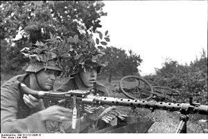 Operation Deadstick - German soldiers with an MG 34 machine-gun.