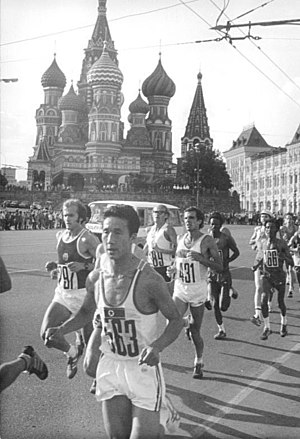Athletics at the 1980 Summer Olympics – Men's marathon - Runner pass in front of Saint Basil's Cathedral. Winner Waldemar Cierpinski is at left.
