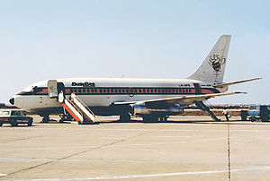 Busy Bee - The airline's Boeing 737-200C at Faro Airport in 1984