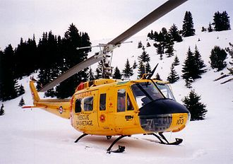 Canadian Armed Forces Search and Rescue - CH-118 Iroquois helicopter from CFB Cold Lake in the mountains of British Columbia.