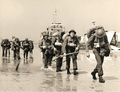 Canadian infantry reinforcements arrive at Courseulles-sur-Mer..png