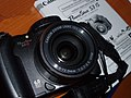 Canon PowerShot S3 IS with its user's manual 20070511.jpg