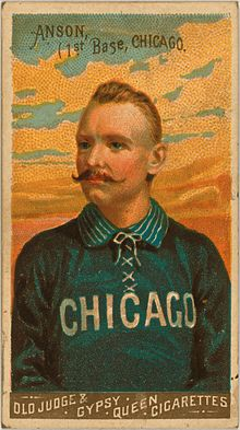 Baseball card depicting a half-length portrait of a mustachioed man in a blue baseball uniform