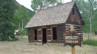 Hinsdale County, Colorado - Capitol City, Colorado, a ghost town on the Alpine Loop National Scenic Back Country Byway. Capitol City once had a population of 400; its founders wanted it to become the capital of Colorado. The post office, some outbuildings, and brick kilns remain.