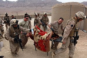 3rd Battalion, 4th Marines - Marines and Sailors tend to the medical needs of an injured boy in Helmand Province, Afghanistan.