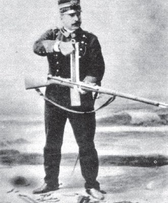 Cei-Rigotti - This circa 1900 photo shows an Italian soldier demonstrating charging and firing a standard and high capacity version of the Cei-Rigotti rifle.