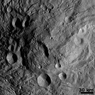 Central Mound at the South Pole on the asteroid Vesta image of NASA's Dawn spacecraft 14f2 311811321 detail