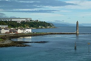 Chaine Memorial - Looking towards Chaine Memorial Tower and north along the Antrim Coast from a ferry entering Larne harbour.