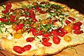 Cheese pizza with tomato and basil.jpg