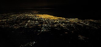 Chicago metropolitan area - Night aerial view of Chicago and vicinity, from Gary, Indiana, on the right, through Waukegan, Illinois, and Kenosha, Wisconsin in the distance at upper left.