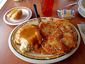 Chicken fried steak - Country fried steak served with mashed potatoes topped with brown gravy