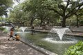 Children enjoy a lovely pond and fountain away from the animals at the Houston, Texas, zoo LCCN2014633257.tif