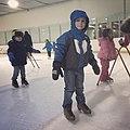 Children learning to skate (16118350289).jpg