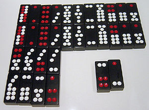 Pai gow - A set of Chinese dominoes. The top double-row of tiles lists the eleven matching pairs, in descending value from left to right. Below them are five non-matching pairs, worth less than the matching pairs, and also in descending value from left to right. The Gee Joon tiles, lower right, are the highest pair of all.