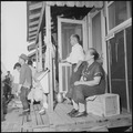 Closing of the Jerome Relocation Center, Denson, Arkansas. An Issei couple sit on their porch and w . . . - NARA - 539783.tif