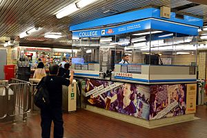 College station (Toronto) - Collector's booth and automatic turnstiles which accept tokens, Metropass and Presto card