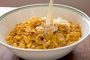 Cornflakes with milk pouring in.jpg