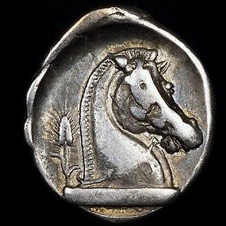 Roman Republican currency - O: Bearded head of Mars with Corinthian helmet left.