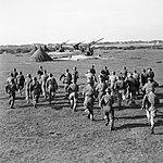 Crews rush to their 3.7-inch guns, 127th Heavy Anti-Aircraft Regiment, Southwold, Suffolk, 9 October 1944. H40434.jpg