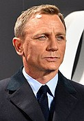 A head shot of a light-haired man in a suit