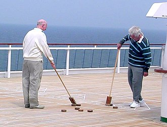 Shuffleboard - A shuffleboard game being prepared on a ship's deck