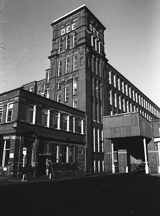 Shaw and Crompton - Dee Mill was designed by Philip Sydney Stott, and built in 1907. Demolished in 1984, the Shaw National Distribution Centre now occupies its site.