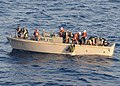 Defense.gov News Photo 100410-N-1082Z-119 - Members of a visit board search and seizure team pull a suspected pirate from the water in the Gulf of Aden prior to returning to the amphibious.jpg