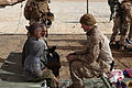 Defense.gov News Photo 101228-M-1392C-085 - U.S. Marine Corps Cpl. Catherine Brousard speaks with Afghan children about hygiene during a village medical outreach mission in Habibabad.jpg