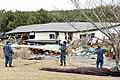 Defense.gov News Photo 110315-N-MU720-010 - U.S. Navy sailors remove debris from a park at the fishing port in Misawa Japan on March 15 2011. More than 120 sailors and airmen from Naval.jpg