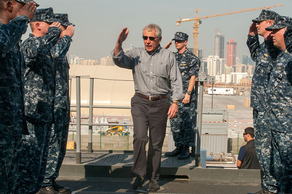 File defense secretary chuck hagel arrives aboard the afloat forward