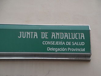 Spanish National Health System - Sign for the headquarters of a Health Office (Delegación de Salud) in Andalusia.