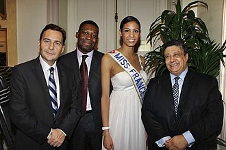 Yazid Sabeg - Éric Besson, Patrick Lozès, Chloé Mortaud (Miss France 2009) and Yazid Sabeg at the annual diner of CRAN, February 5, 2009