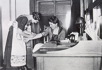 Marie Equi - An assistant with a patient at Equi's Portland, Oregon office