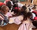 Drawing on disposable plates at Mathare slum, Kenya.jpg