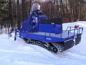 An Alpina Sherpa dual track snowmobile.