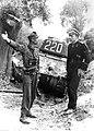 Dwaj żołnierze niemieccy przed zniszczonym radzieckim czołgiem (2-671).jpg