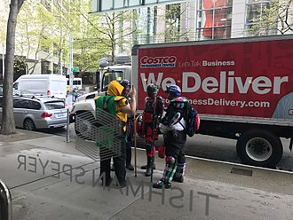 Real-life superhero - SkyMan, Red Ranger, El Caballero, and Dragon (members of Emerald City Heroes Org, or ECHO) monitoring the 2017 May Day protests in Seattle.
