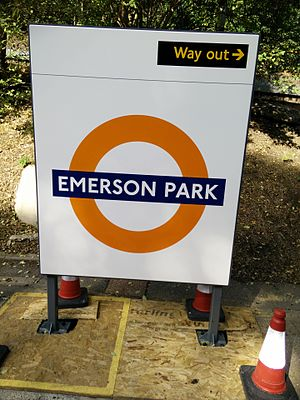 Emerson Park railway station - London Overground roundel signage being installed in 2015