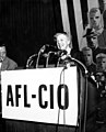 Eleanor Roosevelt speaks at a podium with an AFL-CIO sign, 1957. (5279593094).jpg