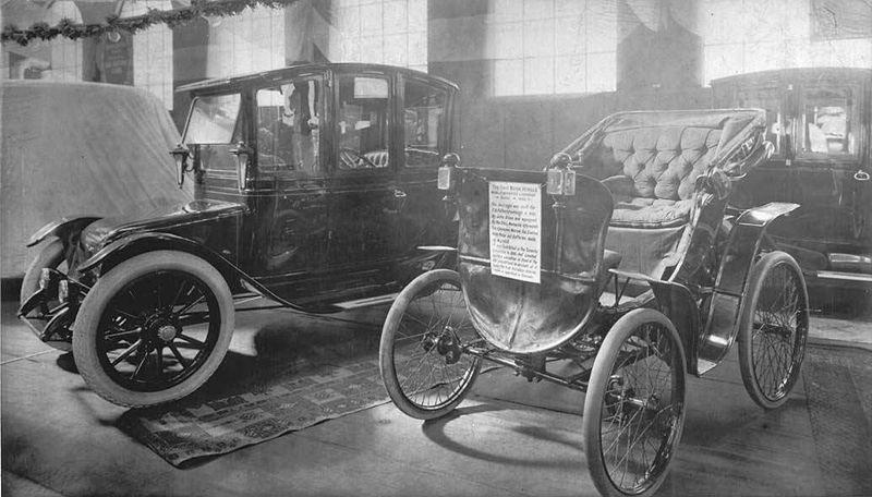 File:Electric car and antique car on display at 1912 auto show.jpg