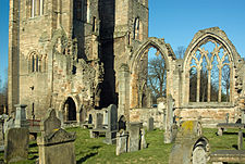 Elgin Cathedral south aisle with windows and south west entrance.jpg