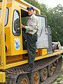 Employee stands on heavy equipment vehicle.jpg