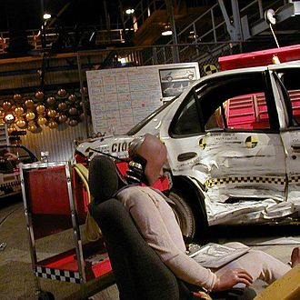 Test Track - The interior of Test Track shows a simulated test lab, including test dummies and damaged cars before the 2012 refurbishment.