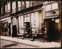 "Eugène Atget, Shop front of ""Courone d'or,"" Quai Bourbon, 1922.jpg"