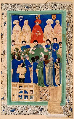 Rectangular peach coloured frame with floral artwork and green trim surrounding a photo of sixteen people around a table dressed in green and blue robes with five people above in tan robes. Below the table is a cage with two people inside.