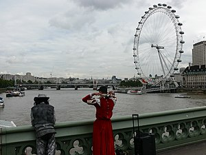Westminster Bridge - Street artists on Westminster Bridge and London Eye in the background