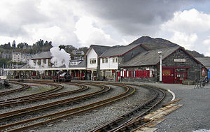 Porthmadog Harbour railway station - Porthmadog Harbour railway station in 2011. The point work of the WHR's Cross Town Rail Link (CTRL) can be seen in the foreground, with the FR's 0-4-0 locomotive Palmerston waiting in the then single platform station to pilot a WHR train back into the platform from the Cob